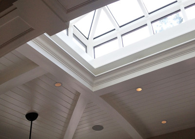 A lantern skylight installed in a beautiful vaulted ceiling allows ample sunlight to enter this Lexington, Massachusetts home