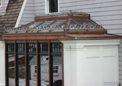 A custom Sunspace glass roof outfitted with ornate ridge cresting for an exquisite decorative effect