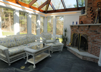 Glass Conservatory with Tile Floor and Patio Furniture