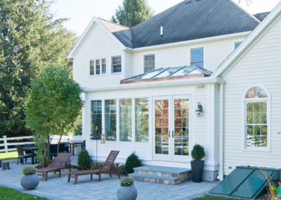 New England Glass Orangery with Exterior Stone Patio