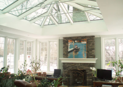 Custom Glass Room Addition with Operational Stone Fireplace