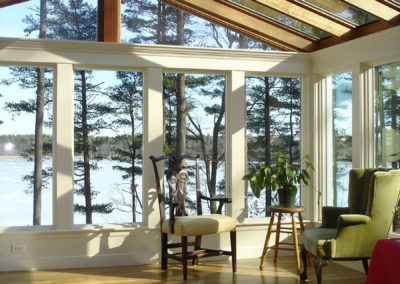 Custom Home Sunroom with Hardwood Flooring
