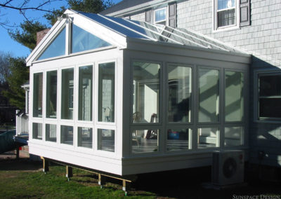 Brand New Custom Sunroom Behind Home