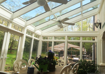 A look at the sloped glass roof of this elegant, traditional conservatory built by Sunspace Design for clients in Massachusetts