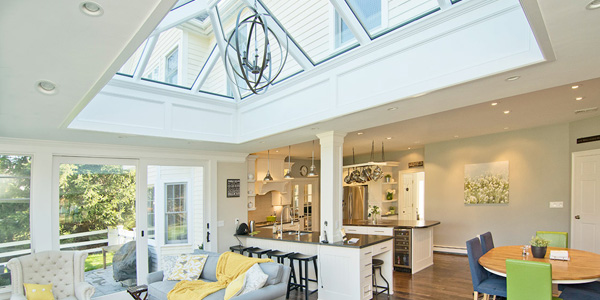 A bright and open kitchen renovtation featuring an orangery-style skylight in Medfield, Massachusetts
