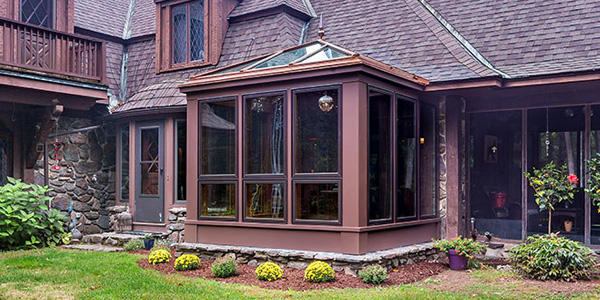 An outdoor photo of an elegant conservatory office built to replace an aging sunroom in North Hampton, New Hampshire