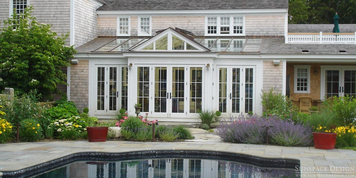 A photo of a magnificent poolside mahogany conservatory and glass roof system located in Martha's Vineyard, Massachusetts