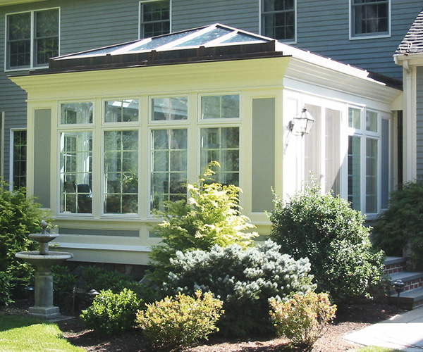 A traditional conservatory featuring large windows with a clerestory that has been designed and installed by Sunspace Design