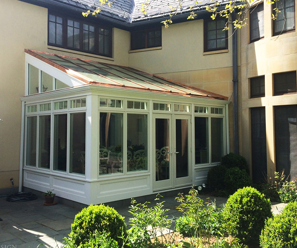 A simple lean-to sunroom with a contemporary design intended to maximize the amount of available floor space
