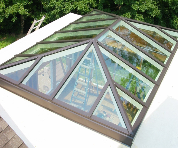 A photo of the Sunspace team hard at work on a double-hip skylight located in Connecticut
