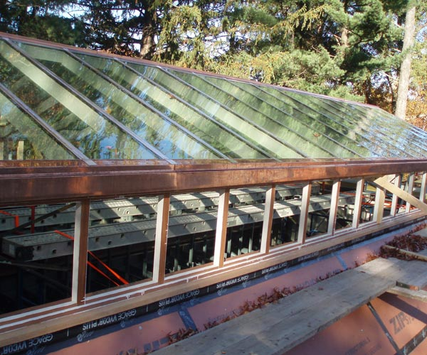 A daytime photo of a 60-foot long gable skylight that's being installed by Sunspace Design in Brookline, Massachusetts