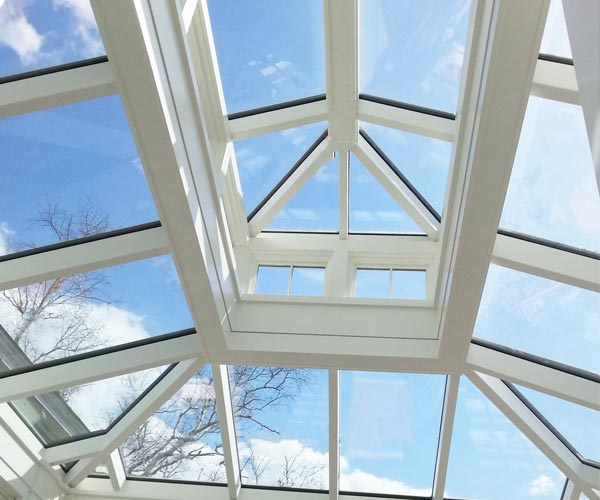 An interior view of a Sunspace lantern skylight and glass roof system with a concealed steel frame in Salem, Massachusetts