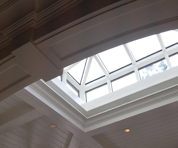 A beautiful Sunspace lantern skylight illuminating a room in Lexington, Massachusetts