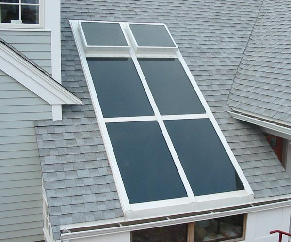 This sloped New England skylight installed by Sunspace Design has been engineered to match the pitch of the roof