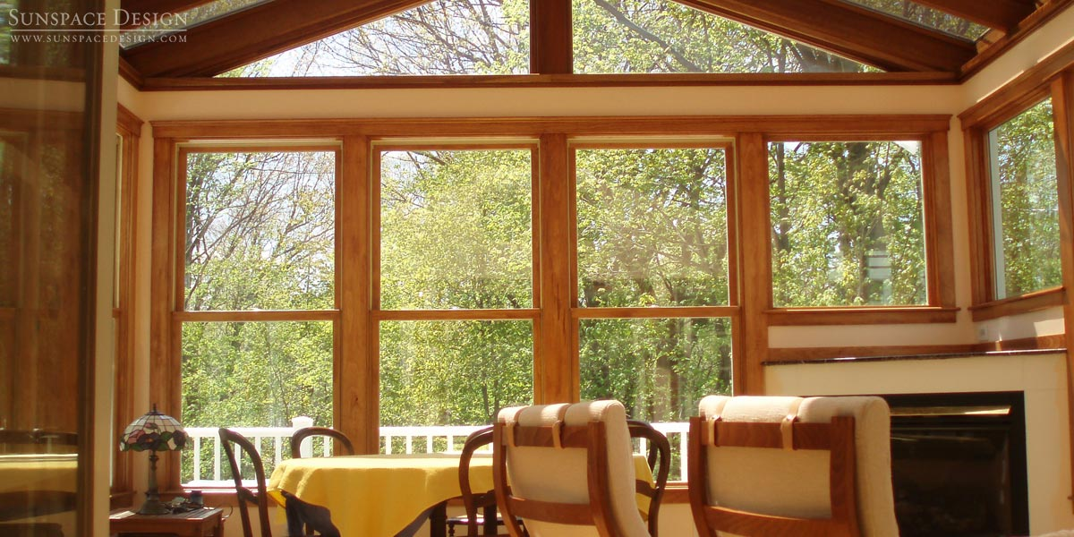 An interior shot of a rustic residential sunroom featuring double hung windows located in Newton, Massachusetts