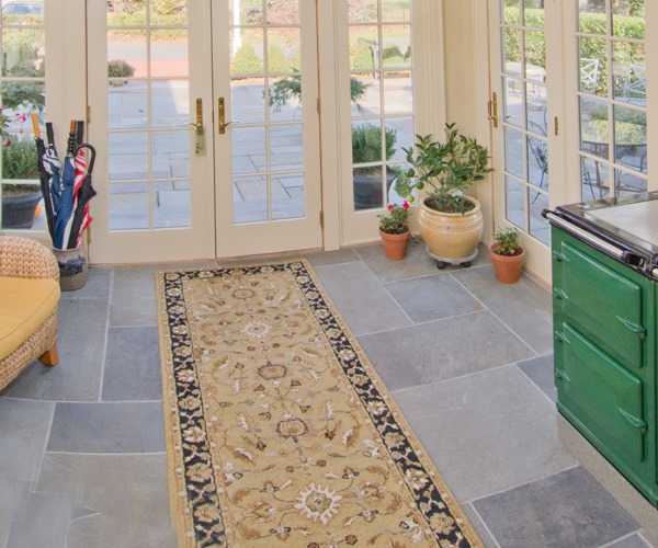 A custom designed orangery in Shrewsbury, Massachusetts featuring slate flooring