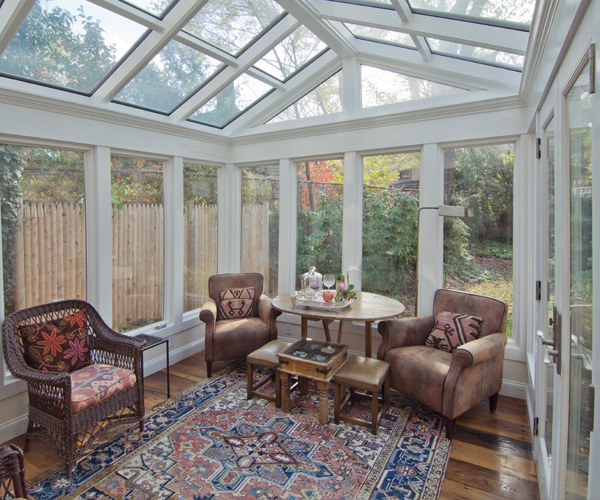 A contemporary conservatory with rustic wide hardwood flooring located in Cambridge, Massachusetts