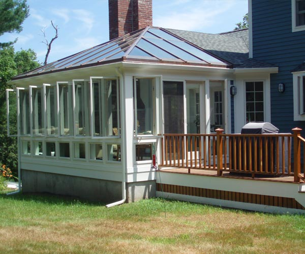 An exterior view of a contemporary conservatory with casement and awning windows located in Hamilton, Massachusetts