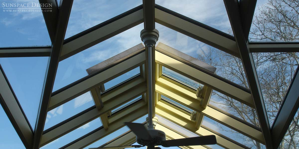A stunning glass dormer roof skylight system above a Sunspace Design conservatory in Martha's Vineyard, Massachsuetts