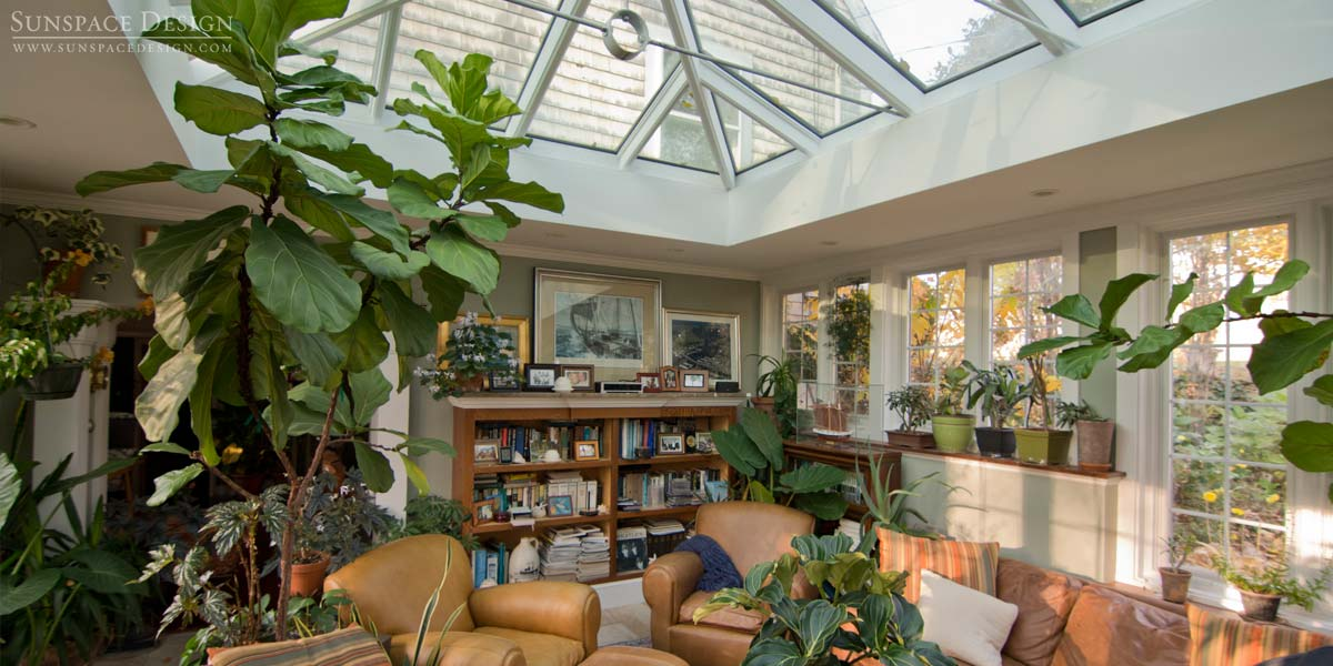 A custom double hip skylight framed in mahogany located above a Cape Cod-style home's family room in Newbury, Massachusetts