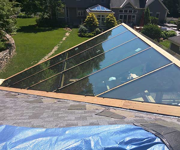 An exterior shot of a pool enclosure's glass roof featuring panes of Solar Ban 70-XL glass