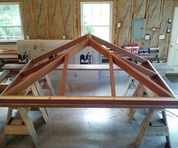 A mahogany glass roof frame being engineered and constructed at one of our shop sites before being transported to the field for installation