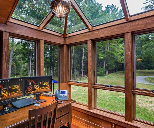 A view of the surrounding natural environment from the interior of a New Hampshire office space home addition