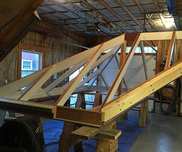 A conservatory's mahogany roof frame is developed in the Sunspace Design shop before being shipped to the construction site in New Hampshire