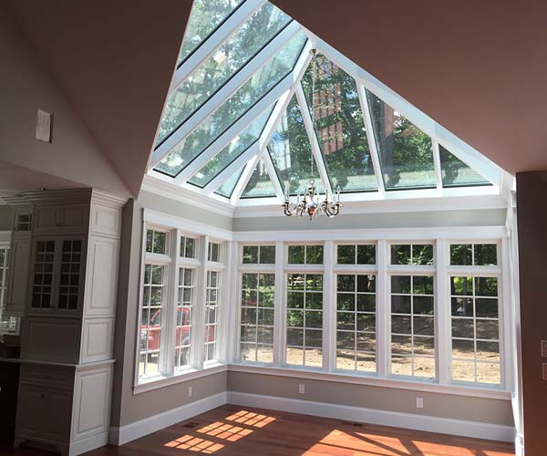 An interior view of the finished, unfurnished conservatory located adjacent to the kitchen