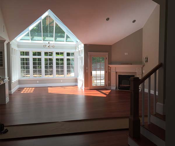 A view of the conservatory and angular glass roof system visible from the entryway of the home