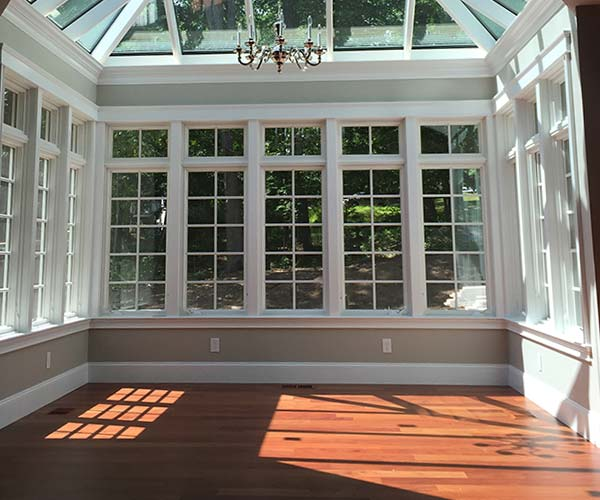 The conservatory interior's floor is elegant mahogany