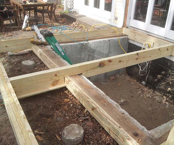 A conservatory floor in the process of being reframed and enlarged