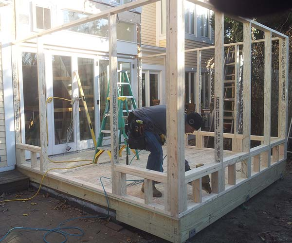 The reframed and enlarged floor provides a foundation for the early stages of wall framing