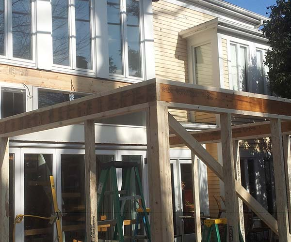 A brand new LVL header has been installed in this glass conservatory renovation project