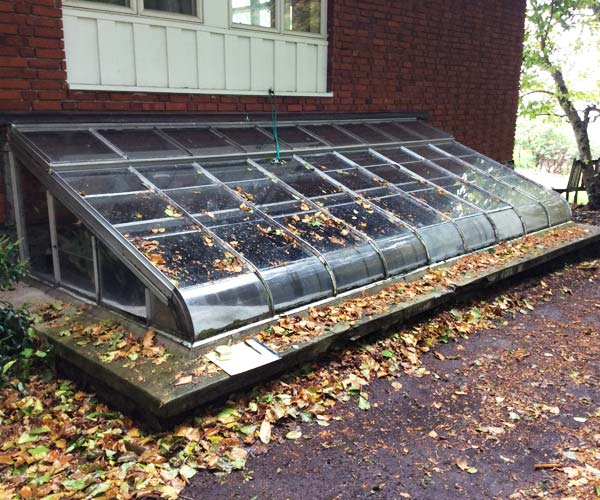 A photo of the existing, aging aluminum skylight that will be removed and replaced with a mahogany framed sylight developed off-site