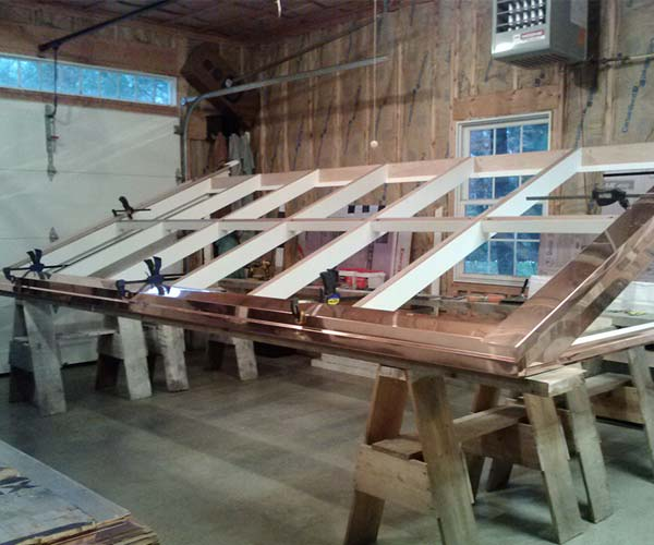 A shop photo of the solid mahogany skylight frame being developed in order to reduce construction costs and project duration