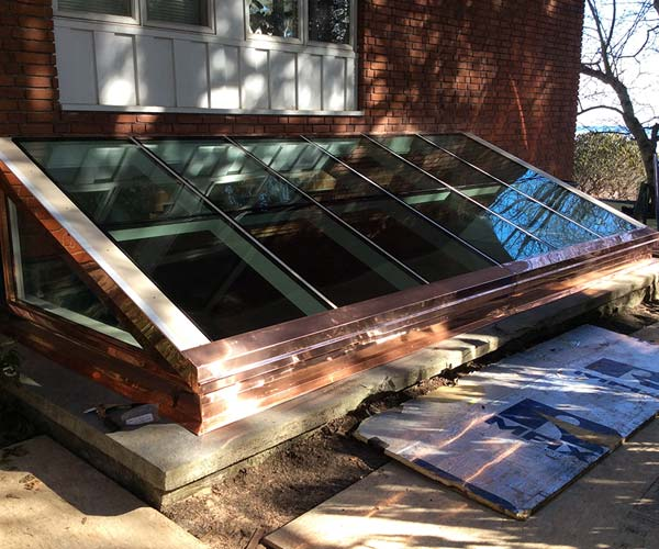 A shot of the brand new skylight with freshly installed insulated PPG Solar Ban 70XL glass outside of this New Hampshire residence