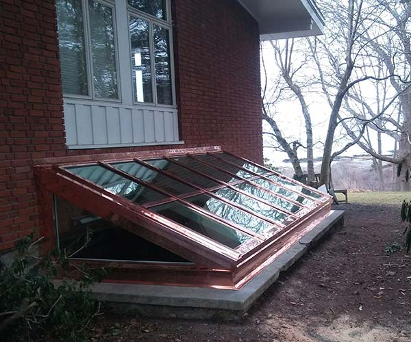An exterior photo of the skylight recently installed on this New Castle property