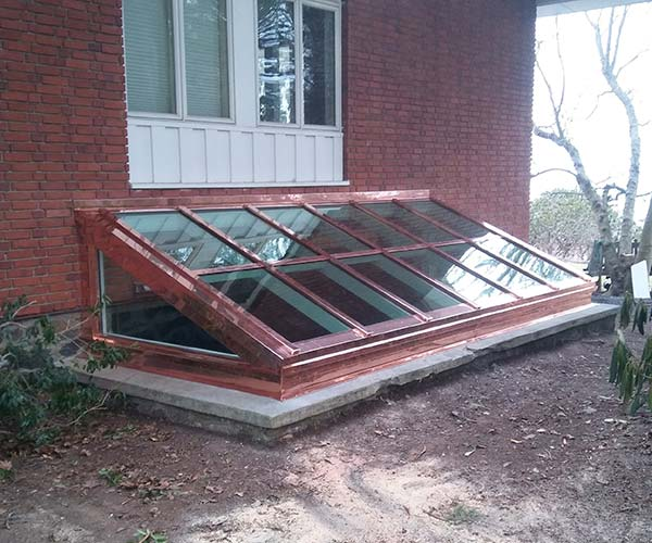 Another exterior photo of the skylight which will flood the basement levels of this home with natural sunlight
