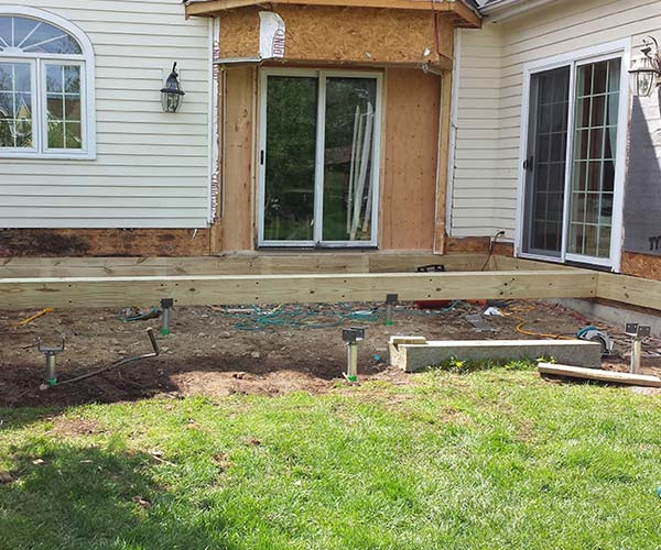 A new floor frame is being constructed to establish the new footprint of the renovated kitchen and entertaining area