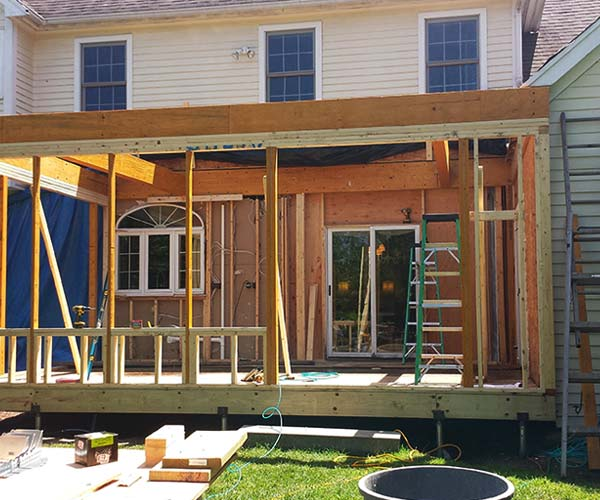 A photo of new window and door framings in the newly framed home addition walls