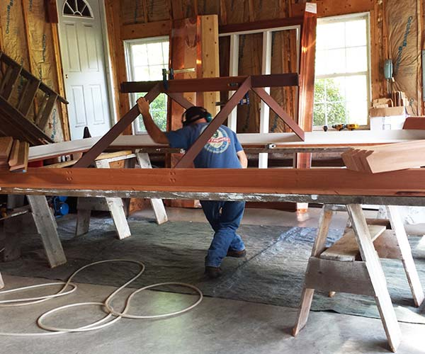 A photo of the project's custom mahogany frame being developed off-site in the Sunspace Design workshop