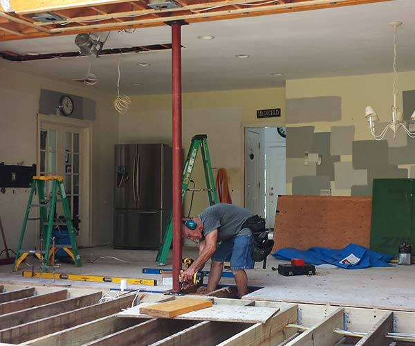 Photo of the open concept home renovation space featuring a newly-merged addition and kitchen