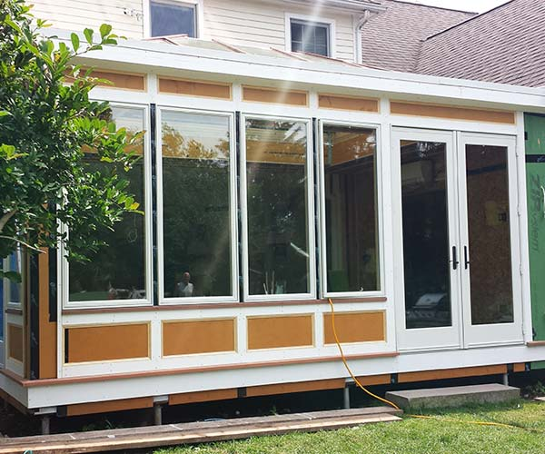 An exterior photo of the Medfield addition that is ready for paint