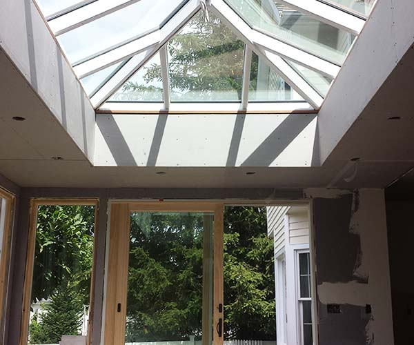 A view of the new orangery-style space featuring a stunning skylight design