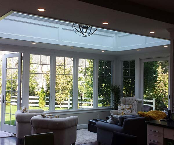 A photo of the completed renovation taken from within this New England kitchen space