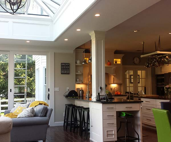 Another view of the finished renovation which blends an entertaining area and a large kitchen