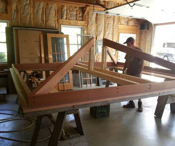 A photo of an orangery hip skylight frame being crafted out of fine mahogany in the Sunspace Design workshop