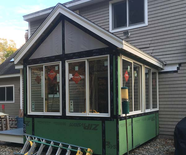 Exterior sheathing encapsulates the new deck enclosure built on this Stratham, New Hampshire property