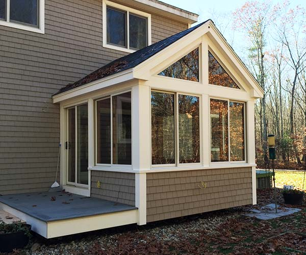 A photograph of the new deck enclosure with trim and architectural details creating a seamless transition with the main residential structure